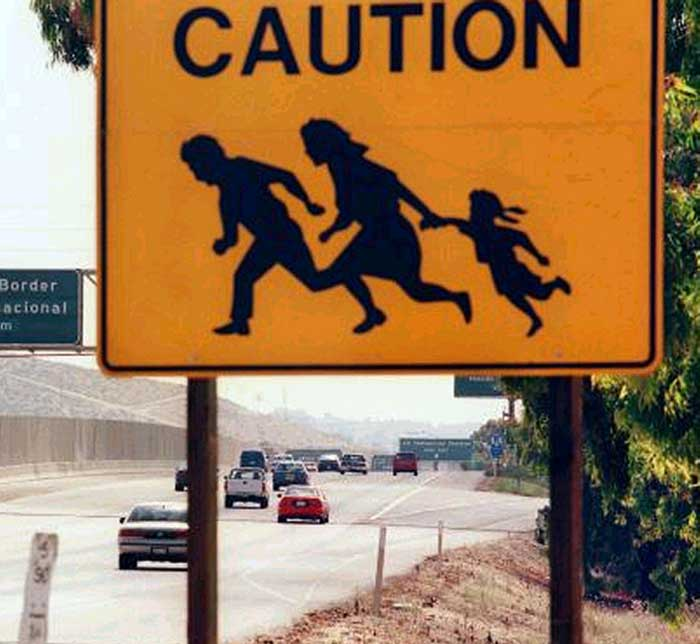 Illegal Aliens Caution Sign