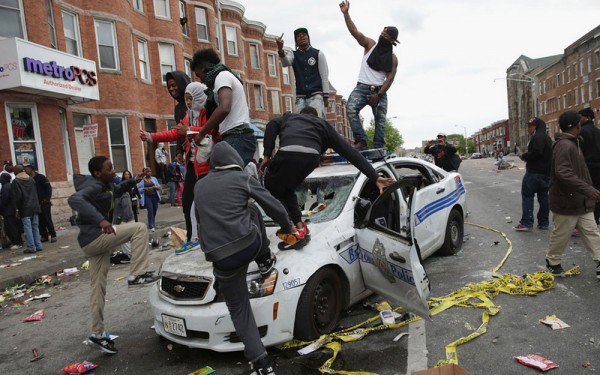 Ferguson-Black-Thug-Criminals-FDance-On-Destroyed-Police-Car